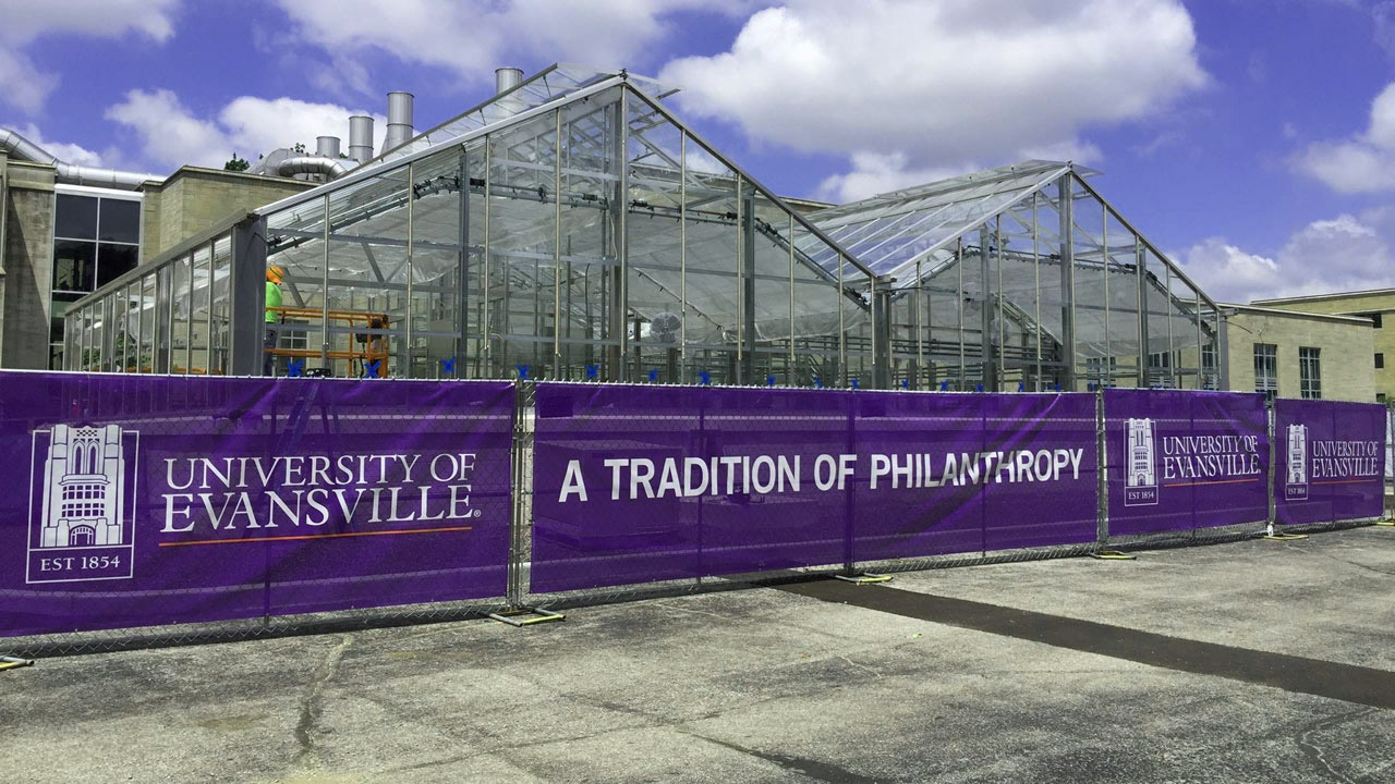New greenhouse construction surrounded by banners that say A Tradition of Philanthropy