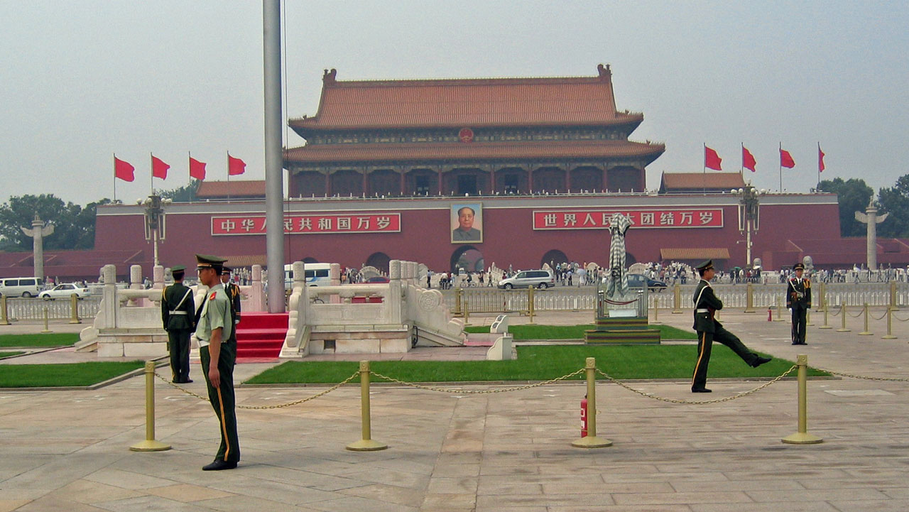 China building with guards in front.