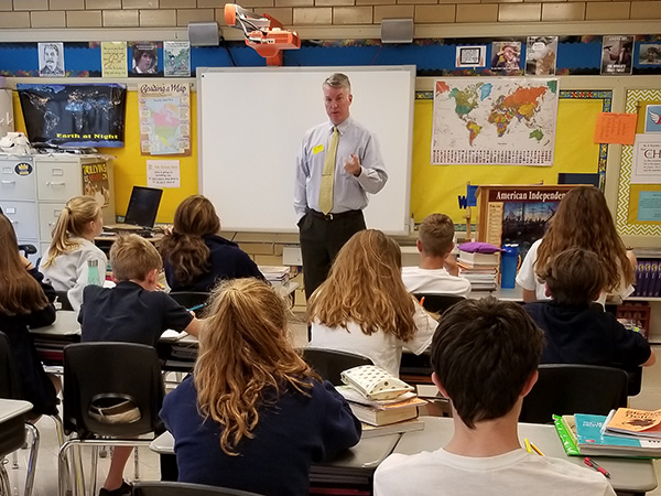 Dion speaks to eighth graders about presidential powers and U.S. Constitution