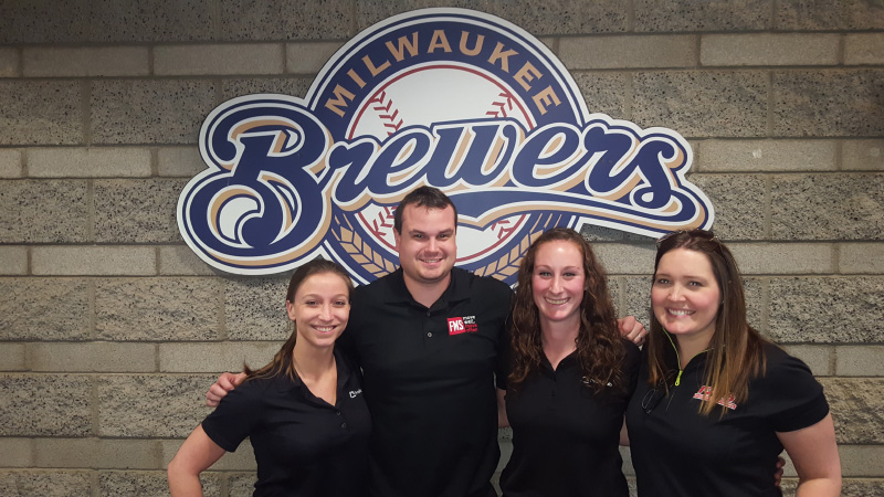 UE faculty, alumni, and sports residents work at MLB spring training