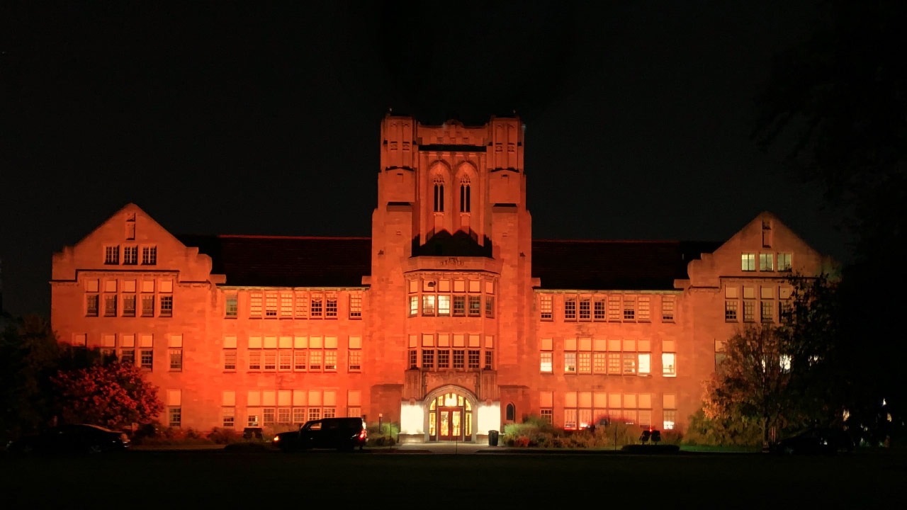 Olmsted Administration Hall in orange lights.