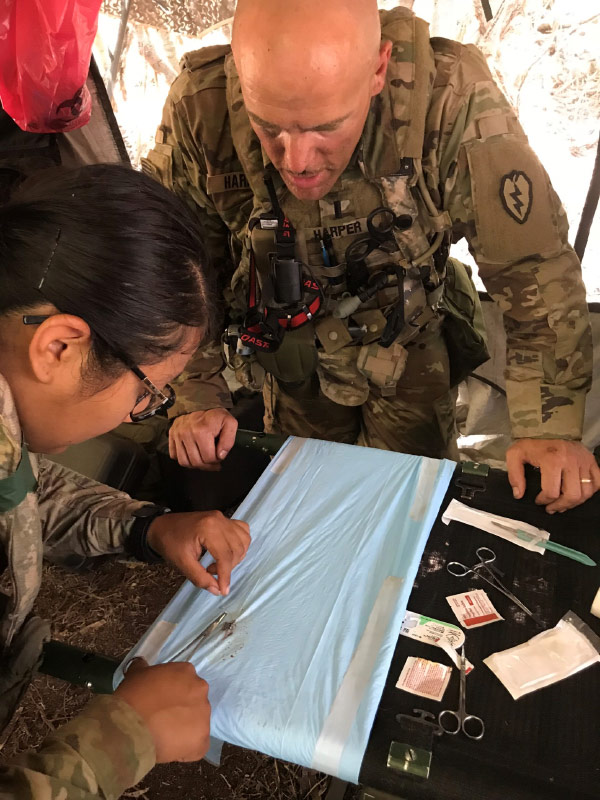 UE professor of physician assistant science Sean Harper trains combat medics