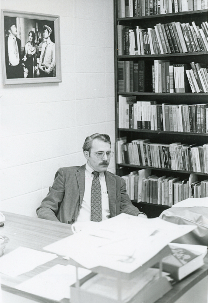 Professor Dudley Thomas sitting at desk in old black and white photo