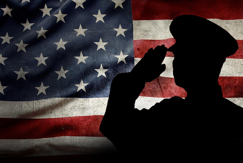 Veteran saluting United States flag