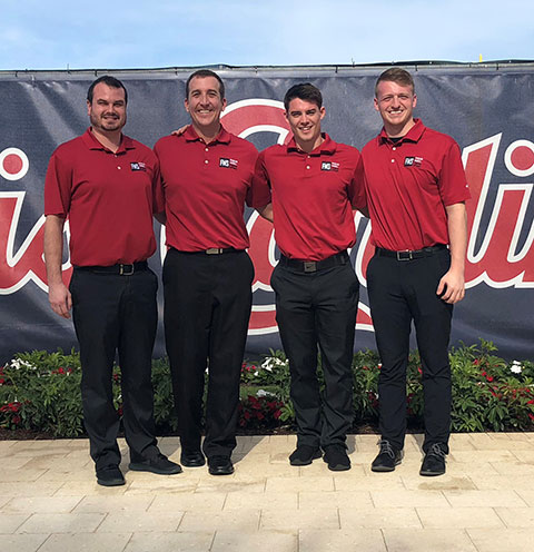 Four men in red shirts