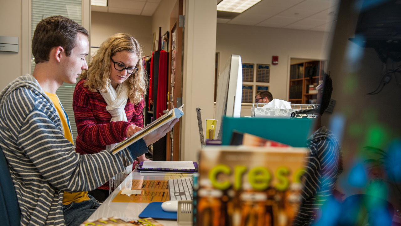 Two UE publication students working together on an upcoming edition of the Crescent Magazine.